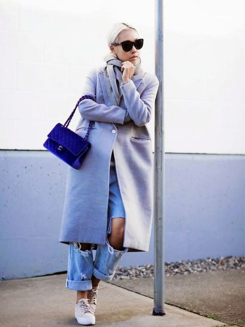 With pastel colored midi coat, navy blue velvet bag and sneakers