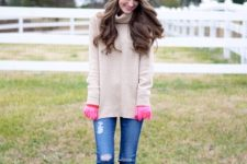 With pastel colored sweater, distressed jeans and suede boots