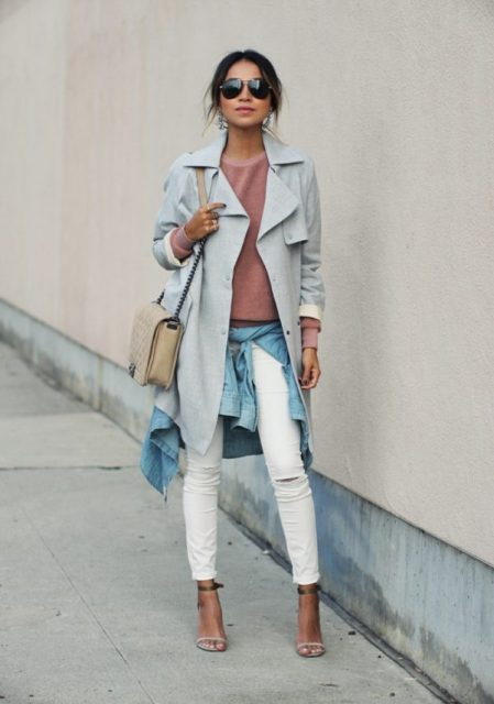 With pink sweatshirt, white trousers, high heels and beige bag