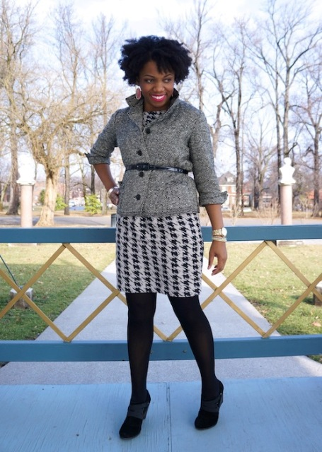 With printed mini dress, black tights and black shoes