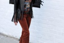 With printed t-shirt, black fringe jacket and black boots