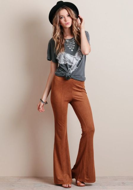With printed t shirt, black hat and brown sandals