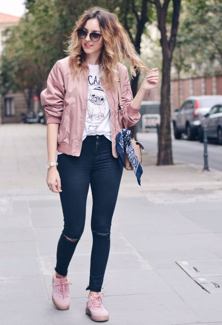 With printed t-shirt, navy blue jeans, chain strap bag and pale pink shoes