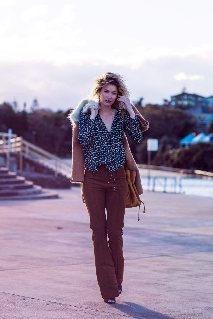 With printed wrap blouse, brown jacket, suede bag and heels
