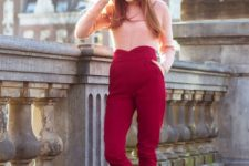 With red high-waisted trousers and pastel colored shoes