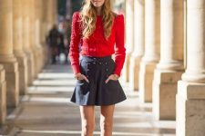 With red sweater, black skater skirt and black boots
