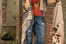 With red top, distressed jeans and brown heeled boots