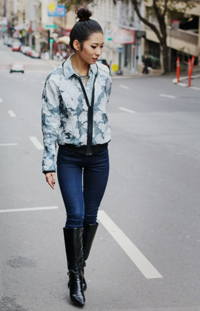 With skinny jeans and black leather high boots