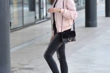 With skinny jeans, white sneakers and black bag