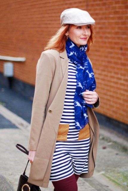 With striped dress, printed scarf, beige coat and bag