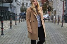 With striped shirt, beige coat, black skinny pants and brown boots