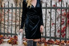 With velvet wrap dress and white rounded bag