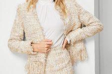 With white blouse and tweed fringe jacket