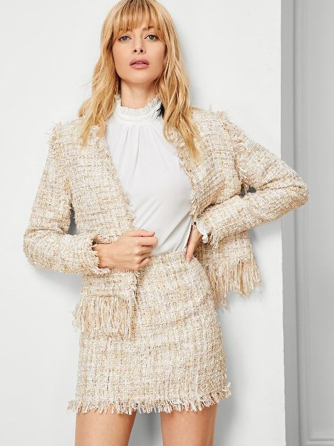 With white blouse and tweed fringe jacket