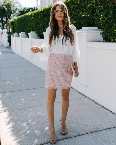 With white blouse, beige clutch and beige ankle strap shoes