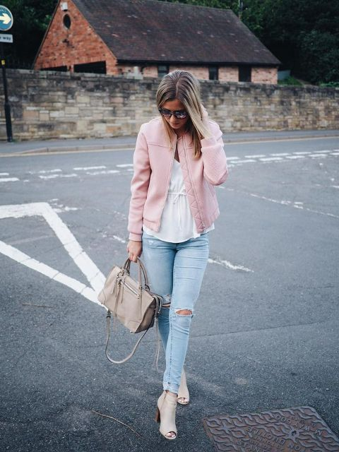 With white blouse, distressed jeans, gray bag and beige cutout boots