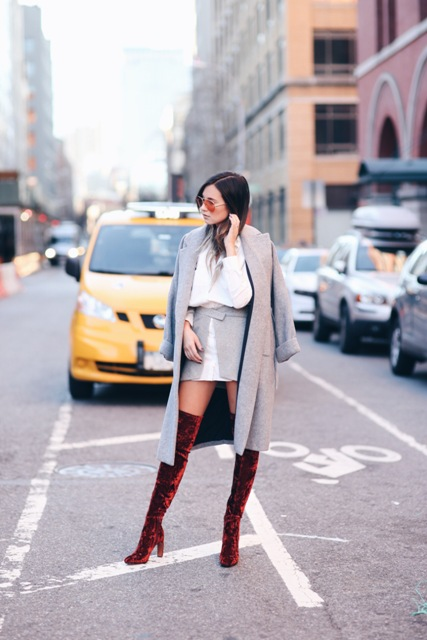 With white blouse, gray mini skirt and gray midi coat