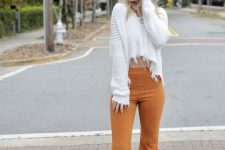 With white crop sweater and high heels