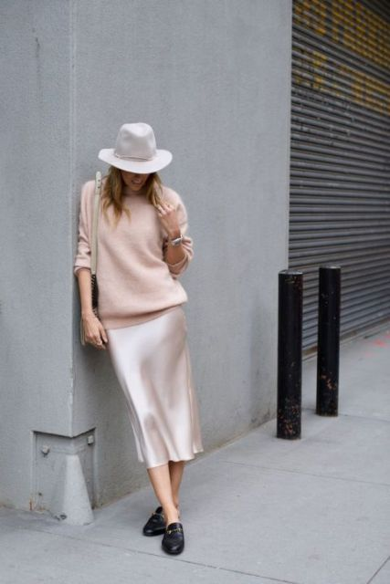 With white hat, bag, satin midi skirt and black shoes