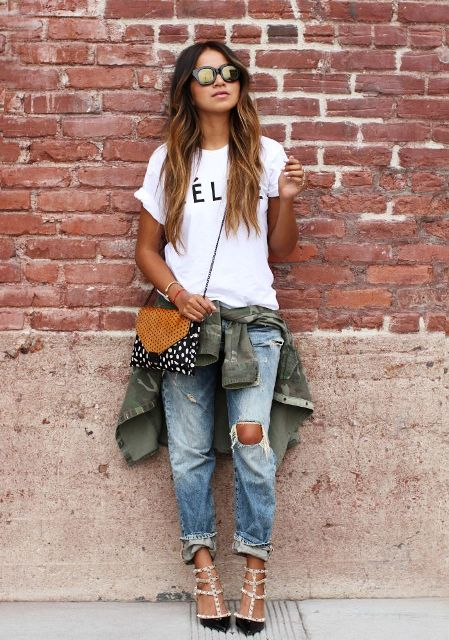 With white labeled t-shirt, olive green jacket, printed bag and embellished shoes
