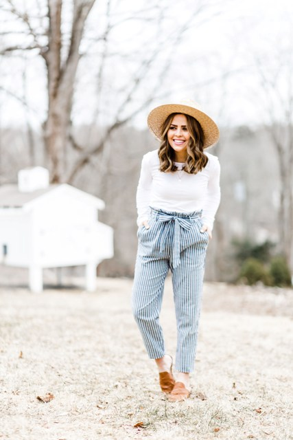 With white long sleeved shirt, wide brim hat and brown shoes