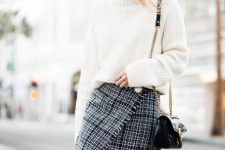 With white loose sweater, chain strap bag and black over the knee boots