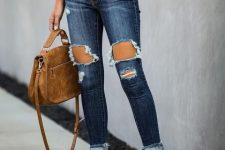 With white loose t-shirt, brown leather bag and beige ankle strap high heels