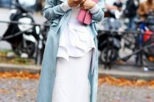 With white maxi dress, pale pink clutch and transparent shoes