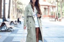 With white mini dress, fishnet bag and sneakers