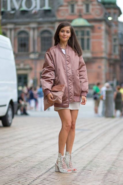 With white mini dress, pale pink clutch and lace up shoes