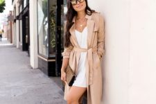With white mini dress, printed clutch and brown suede high boots