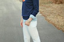 With white pants, light blue shirt and navy blue sweater