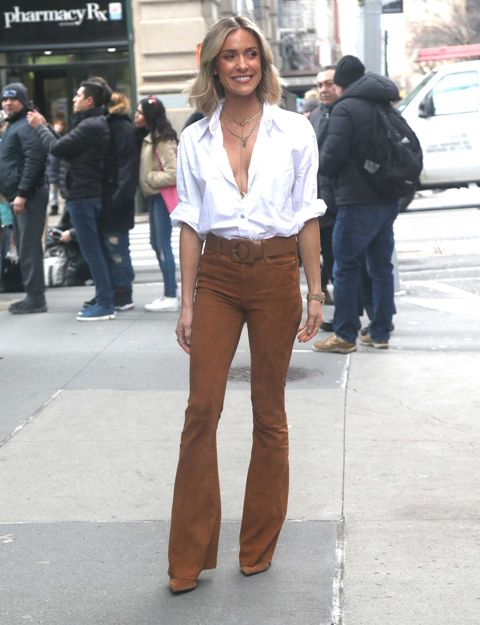 With white shirt and brown suede pumps