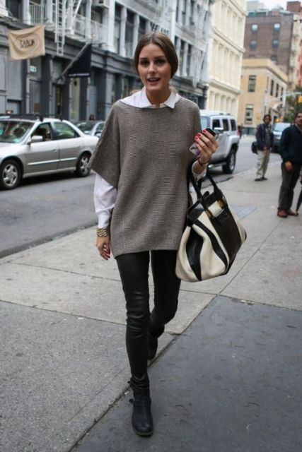 With white shirt, black leather skinny pants, white and black bag and black boots