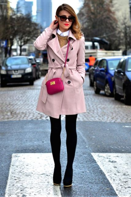 With white shirt, brown sweater, skirt, black boots and pink bag