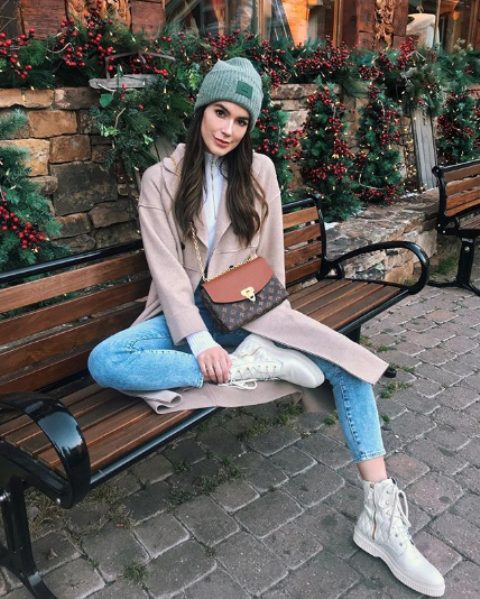 With white shirt, coat, cropped jeans, printed bag and white boots