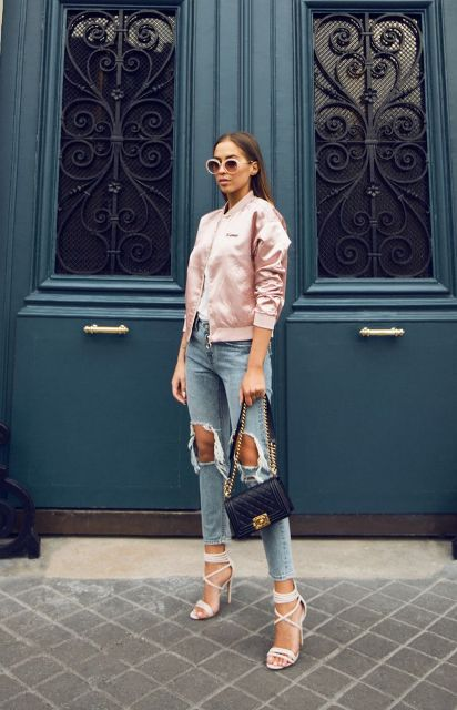 With white shirt, distressed jeans, chain strap bag and beige lace up high heels
