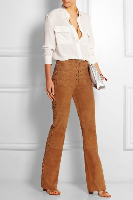 With white shirt, white clutch and brown sandals
