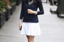 With white skirt and navy blue shirt