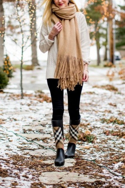 With white sweater, beige fringe scarf and black leggings