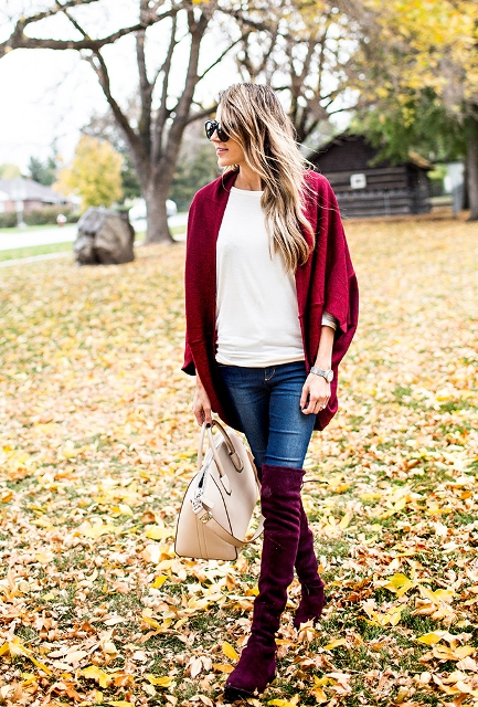With white t-shirt, beige leather bag, navy blue jeans and marsala cardigan