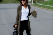 With white t-shirt, black skinny pants, black bag and leopard printed flat shoes