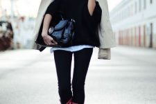 With white t-shirt, black sweater, beige jacket, black patent leather bag and skinny pants