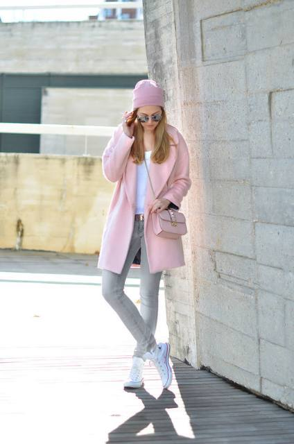 With white t-shirt, gray jeans, pale pink coat, chain strap bag and white sneakers