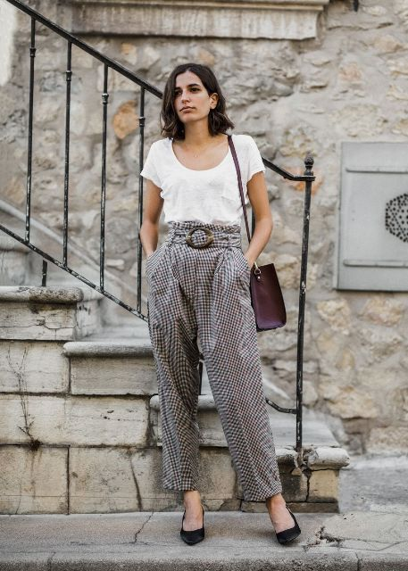 With white t-shirt, purple bag and black pumps