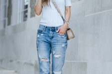 With white t-shirt, shoes and beige crossbody bag