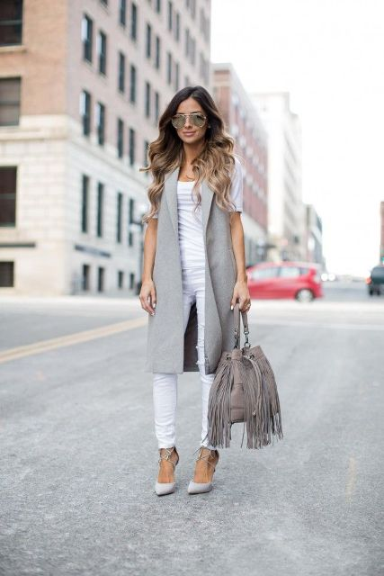 With white t shirt, white pants, gray long vest and gray lace up shoes