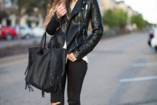 With white top, black leather jacket, distressed pants and beige high heels