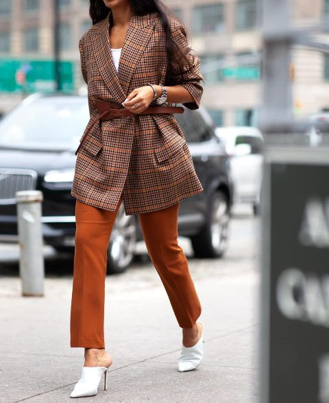 With white top, brown pants and white heeled mules