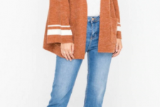 With white top, flare jeans and brown lace up sandals